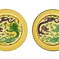 A pair of yellow-ground green and aubergine-enamelled 'dragon' dishes, Guangxu six-character seal marks in aubergine enamel and of the period (1875-1908)
