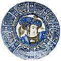 <b>Chinese</b> <b>style</b> Iranian dish with an image of a dandy. North-west Iran, early AD 1600s.