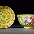 A yellow-ground 'Dragon and <b>Phoenix</b>' medallion bowl, and a famille rose 'Shou and Bats' dish, Guangxu marks and period