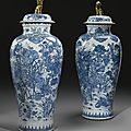 A pair of blue and white '<b>Soldier</b>' <b>vases</b>, Qing Dynasty, Kangxi Period (1662-1722)