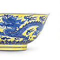 A fine yellow-ground blue and white '<b>dragon</b>' <b>bowl</b>, Kangxi six-character mark within double-circles and of the period (1662-1722)