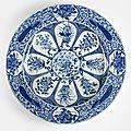 A large blue and white 'peacock and flower' plate from the collection of augustus the strong (1670-1733), kangxi period