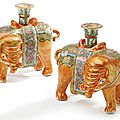 A pair of chinese export porcelain canton famille-rose 'elephant ' candlesticks, mid 19th century