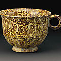 A rare yellow-glazed <b>marbled</b> pottery cup, Tang dynasty (AD 618-907)