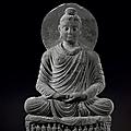 A gray schist figure of a <b>Seated</b> <b>Buddha</b>, Gandhara, 2nd-3rd century