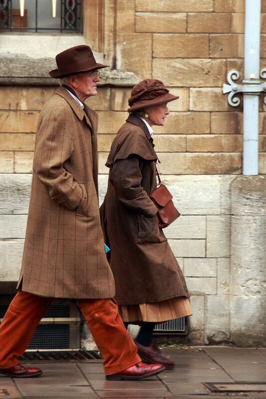 A couple walking along Oxford Street by chaps style