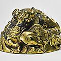 A rare gilt-bronze 'mythical beast' weight, Western Han dynasty