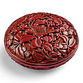 A rare cinnabar lacquer 'floral' box and cover, Incised mark and of <b>Yongle</b> (<b>1403</b>-<b>1424</b>)