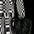 Homage to Vasarely (detail), 1965. By Roberto Capucci (Italian, b. 1930). Rue Cambon Atelier Paris. Dress, black and white woven satin ribbons, 'optical' effect, black plumes. Claudia Primangeli / L.e C. Service. Courtesy of the Philadelphia Museum of Art