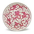 A rare and large puce-enameled 'Five Dragon' dish, Qing dynasty, 19th century