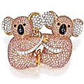 18 karat two-color gold, pink diamond, diamond and onyx double-clip brooch, graff
