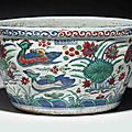 An important <b>and</b> extremely rare wucai 'Ducks <b>and</b> Lotus Pond' fish bowl, <b>Wanli</b> <b>six</b>-<b>character</b> <b>mark</b> <b>and</b> <b>of</b> <b>the</b> <b>period</b> (1573-1619)