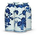 A blue and white 'flowers of <b>the</b> <b>four</b> <b>seasons</b>' conjoined vase, Qianlong seal mark in underglaze blue and of <b>the</b> period