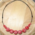 Collier perles rouges...