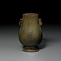 A rare miniature tea-dust-glazedhu-form vase, Qianlong four-character inscribed seal mark and of the period (1736-1795)
