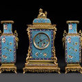 A French late 19th century <b>Chinese</b> <b>style</b> ormolu-mounted and cloisonné enamel three-piece clock garniture