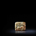 A rare Imperially-inscribed pale green and russet jade 'three rams' plaque The jade Ming Dynasty, the inscription dated to <b>1772</b>