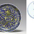 <b>A</b> yellow and <b>blue</b> dragon dish, <b>Kangxi</b> <b>six</b>-<b>character</b> <b>mark</b> <b>in</b> <b>underglaze</b> <b>blue</b> <b>within</b> <b>a</b> <b>double</b> circle and of the period (1662-1722)