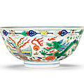 A wucai 'dragon and phoenix' bowl, Daoguang seal mark and of the period (1821-1850)