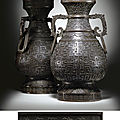 An important and very significant pair of imperial bronze <b>altar</b> <b>vases</b>, Qianlong six-character cast marks in a line within a pane
