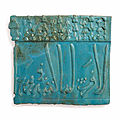 A moulded <b>turquoise</b>-<b>blue</b> glazed pottery border tile, Kashan, Central Iran, 13th century