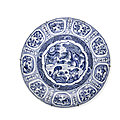 A large blue and white foliate-rim 'Kraak <b>porcelain</b>' charger, Wanli Period, Early 17th century