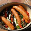 Gratin de saucisses de montbéliard, tian de légumes au thym