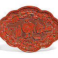 A rare and finely carved lobed <b>cinnabar</b> <b>lacquer</b> 'Washing the elephant' dish, Jiajing six-character incised mark and of the perio