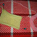 Une méthode pour coudre un col ou des bordures sur un ouvrage tricoté