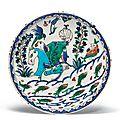 A rare figural rimless <b>Iznik</b> <b>pottery</b> <b>dish</b>, Ottoman Turkey, circa 1570