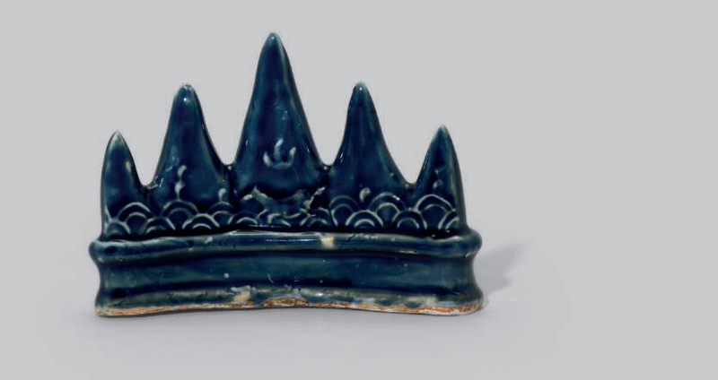 A blue-glazed 'mountain' brush rest, Ming dynasty (1368-1644)