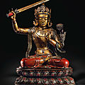 A magnificent and very rare large lacquered and gilt wood seated figure of Manjushri, <b>Kangxi</b> <b>period</b> (1662-1722)