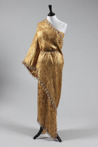A Balenciaga gold ''Sari'' dress worn by Elizabeth Taylor at the premiere of the New Review Lido in Paris. Photo courtesy Kerry Taylor Auctions.