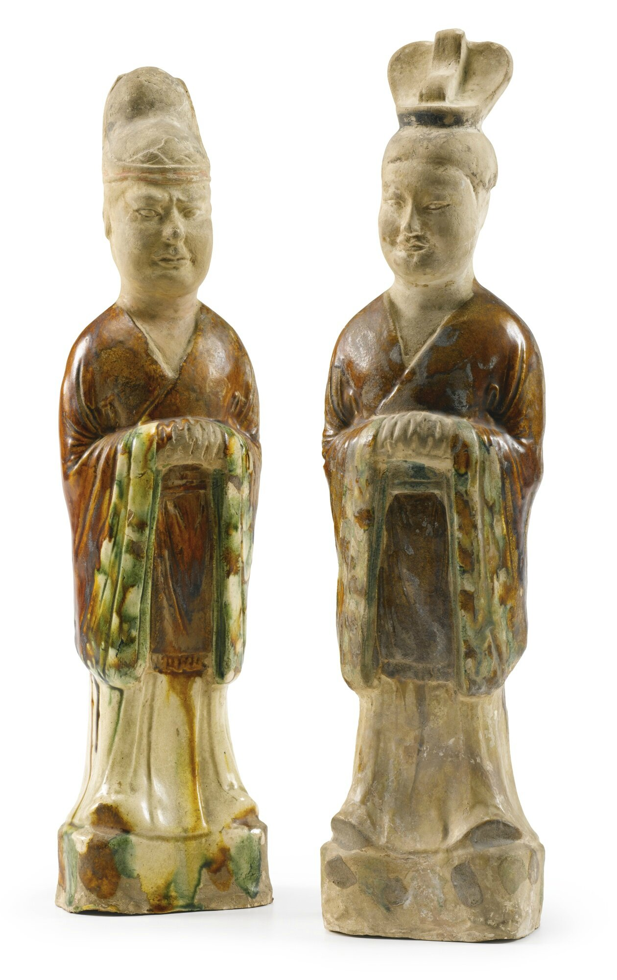 A pair of 'sancai'-glazed figures of officials, Tang dynasty (618-907)