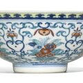 A doucai 'floral' bowl, qianlong seal mark and period