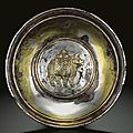 A fine and very rare <b>parcel</b>-<b>gilt</b> 'rhinoceros' <b>silver</b> dish, Tang dynasty, 8th-9th century