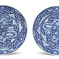 A pair of rare and large blue and white 'dragon' dishes, kangxi marks and period (1662-1722)