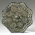 A bronze 'baoxianghua' octafoil mirror, tang dynasty