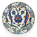 An Iznik polychrome pottery dish with lotus blossom and saz leaves, Turkey, second half 16th century
