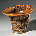 An exceptional inscribed rhinoceros horn 'drunken poet' libation cup signed by You <b>Kan</b>, Qing dynasty, Kangxi period