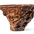A finely carved rhinoceros horn '<b>Chilong</b> <b>and</b> <b>Lingzhi</b>' libation cup, 17th century