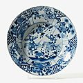 A deep blue and white dish with waved rim, Kangxi six character mark and period