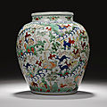 A wucai '<b>Hundred</b> deer' vase, Wanli mark and period & A large wucai baluster vase, 17th century