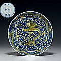A fine yellow and <b>blue</b> 'Dragon' dish, Kangxi six-character mark in underglaze <b>blue</b> within a double circle and of the period (166