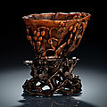 A well carved rhinoceros horn wine <b>cup</b> with grapewine carving, 18th century