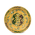 A large yellow-ground green and aubergine-enameled 'dragon' charger, Qing dynasty, Chuxiugong mark and <b>Guangxu</b> <b>period</b> (1875-1908