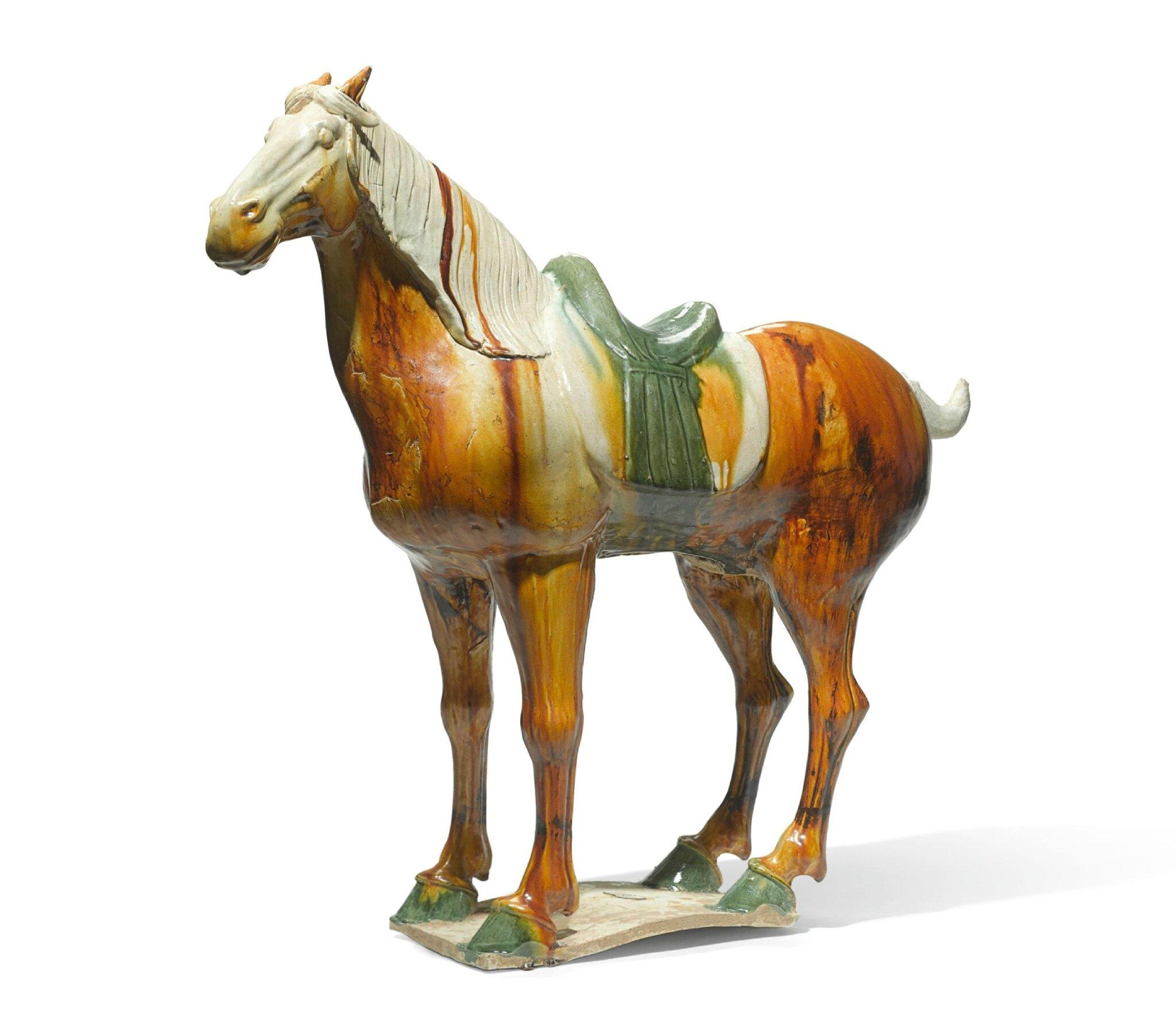 A large sancai-glazed pottery figure of a horse, Tang Dynasty (618-907)