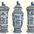 A <b>garniture</b> of three Dutch Delft polychrome vases and covers, early 18th century