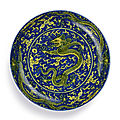 A <b>blue</b>-<b>ground</b> <b>yellow</b>-<b>enamelled</b> 'Dragon' dish, Mark and period of Kangxi (1662-1722)