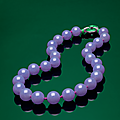 An important <b>lavender</b> jadeite and diamond necklace